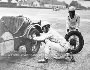 Austin 7 TT Model. Photo. Hon Victoria Worsley and RSL Boote change tyres(Photo A)